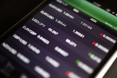 Foreign exchange market chart at smart phone Royalty Free Stock Images