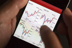 Foreign exchange market chart at smart phone Royalty Free Stock Photography