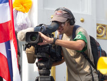 Foreign journalist at an event the protests in Thailand. Stock Photos