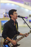 Foreign male singer with electric guitar. Foreign male singer singing in xiamen real estate exhibition, amoy city, china. 2014 Royalty Free Stock Photos
