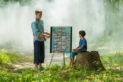 Foreign man teaching English language to Thai rural girl Stock Photos