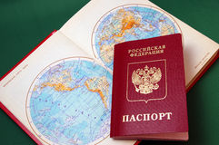 The Foreign passport and card of the world. Royalty Free Stock Image