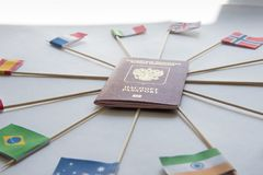 Foreign Passport Of Russian Federation And Flags Of Different Countries Sticked Into Passport Around: India, Brazil, UK,Italy Stock Photos