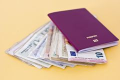 Foreign passports and money from different countries. Foreign passports and money from the countries Royalty Free Stock Photography