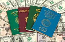 Foreign Passports over US dollars bills Royalty Free Stock Photo
