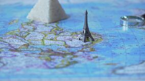 Foreign passports and souvenirs from summer vacation on map, travel by car. Stock footage stock footage