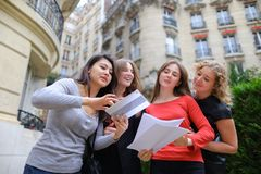 Foreign students learning English with papers near university bu royalty free stock images