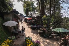 Foreign tourist buying souvenirs in Doi Pui Hmong Hill Tribe Village, Chiang Mai, Northern Thailand royalty free stock photos