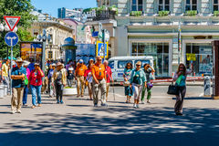 Foreign tourists in Arbat street of Moscow Stock Images