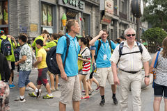 Foreign tourists in Beijing qianmen street Royalty Free Stock Photography