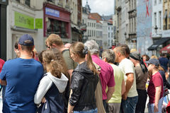 Foreign tourists listens to their guide Stock Photos