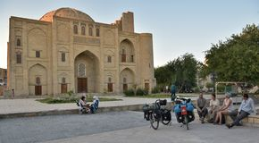 Foreign tourists and locals in the squares and streets of ancient Bukhara in Uzbekistan. Bukhara, Uzbekistan - 05 August 2015: Foreign tourists and locals in Stock Photos