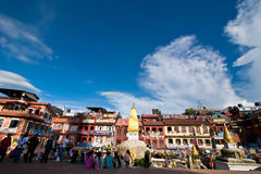 Foreign tourists and pilgrims visiting Boudhanath Stupa. Nepal, Kathmandu Stock Photos
