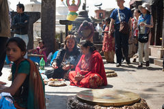 Foreign tourists and pilgrims visiting Swayambhunath Stupa. Nepal, Kathmandu Stock Photos
