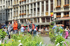 Foreign tourists take pictures on Grand Place in Brussels Royalty Free Stock Image