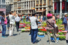 Foreign tourists take pictures of Grand Place in Brussels Royalty Free Stock Images