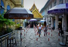 The Foreign tourists to visit the Temple of the Emerald Buddha Wat Phra Kaew royalty free stock image