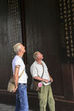 Foreign visitors watching poems in wangjiang park,chengdu,china Royalty Free Stock Photo