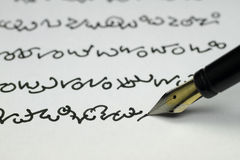 Foreign writing. A text in a foreign writing is not legible Royalty Free Stock Image