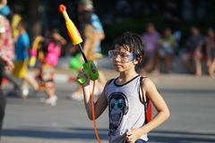 Foreigner kid prepare playing water during Songkran. Songkran is celebration of the Thai New Year which is every 13 April. However, the Thai government extends Royalty Free Stock Photos