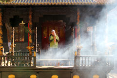 A foreigner praying in a temple Stock Photo