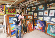 Foreigner take photo on painting in art show Stock Photos