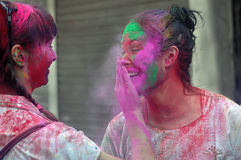 Foreigners Celebrating Holi. Foreigners celebrate the festival of colour Holi in India. Each year tourist from different countries comes to India to celebrate Royalty Free Stock Images