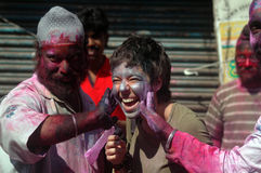 Foreigners Celebrating Holi. Foreigners celebrate the festival of colour Holi with Indians in India. Each year tourist from different countries comes to India to Stock Images