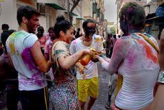 Foreigners in India. March 22, 2011. Free school street,Kolkata,West Bengal,India,Asia-Tourists celebrate the Holi Festival. The most anticipated festivals on Royalty Free Stock Photography