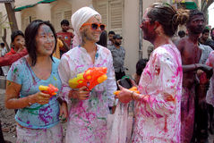 Foreigners in India. March 22, 2011. Free school street,Kolkata,West Bengal,India,Asia-Foreign tourists smeared with colours to celebrate Holi, in Kolkata Royalty Free Stock Photo