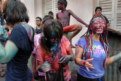 Foreigners in India. March 22, 2011. Free school street,Kolkata,West Bengal,India,Asia-Foreigners playing with colours in Kolkata during the holi festival Royalty Free Stock Image