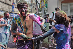 Foreigners in India. March 22, 2011. Free school street,Kolkata,West Bengal,India,Asia-Tourists celebrate the Holi Festival. The most anticipated festivals on Royalty Free Stock Photos