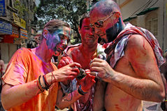 Foreigners in India. March 22, 2011. Free school street,Kolkata,West Bengal,India,Asia-Foreigners showing photographs from the camera during holi festival Royalty Free Stock Photo