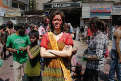 Foreigners in India. March 22, 2011. Free school street,Kolkata,West Bengal,India,Asia-Foreigners pose after playing with colours on the street of Kolkata during Royalty Free Stock Images