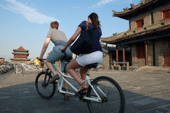 Foreigners riding bicycle on the ancient city wall in xian Royalty Free Stock Photography