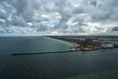 Foreland in blue sea in USA. Foreland in blue sea or ocean water on cloudy sky background in Fort Lauderdale, USA. Tourism and tourist destination. Summer Royalty Free Stock Photos