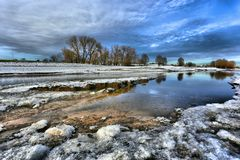 Forelands of the Waal river in Gelderland on a cold winter day in the Netherlands. Forelands of the Waal river in Gelderland on a cold winter day with clear blue Stock Photo