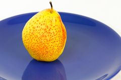 Forelle Pear. A forelle pear displaying red spots on its yellow skin stock photography