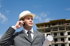 Foreman. Portrait of confident foreman calling by the phone and holding document Royalty Free Stock Photos