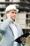 Foreman. Portrait of confident foreman calling by the phone and holding the document stock photography