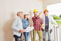 Foreman and architects cooperating. And planning during meeting on site stock photos