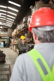 Foreman With Arms Crossed Standing At Warehouse Royalty Free Stock Photography