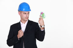 Foreman with bank notes Stock Photos