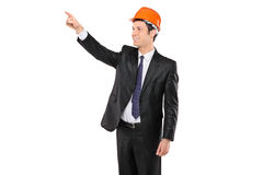 Foreman in a black suit pointing. A view of a foreman in a black suit pointing isolated against white background Stock Photo