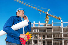 Foreman with blueprints. At construction site stock photo