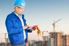 Foreman with blueprints. At construction site royalty free stock photos