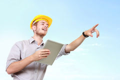Foreman on building site with hard hat giving the instruction. To his worker Royalty Free Stock Image