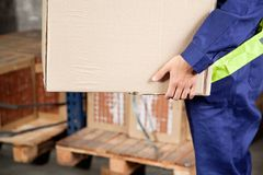 Foreman Carrying Cardboard Box At Warehouse Stock Photos