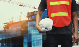 Foreman checking location construction site. And hold helmet royalty free stock photos