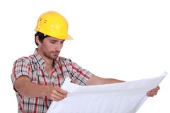 A foreman checking plans. Royalty Free Stock Photos